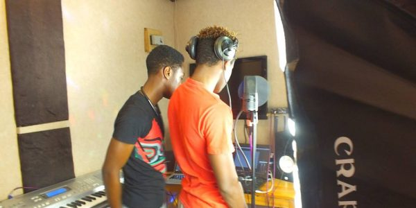 TWO STUDENTS PRODUCING A SONG